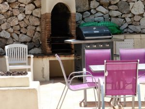 Villa Maxine view of terrace with BBQ & table and  chairs